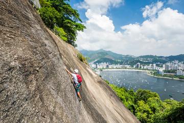 Man rock climbing Morro da Urca, Rio de Janeiro, Brazil