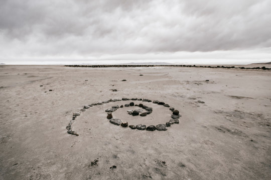 Spiral rock art in barren landscape near Spiral Jetty, Spiral Jetty, Utah, USA