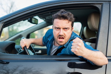 Driver frustrated portrait while driving his car