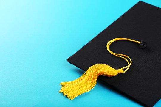 Graduation cap on blue background
