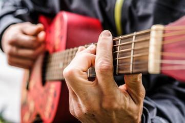 Man playing guitar, Val di Mello, Val Masino, Italy
