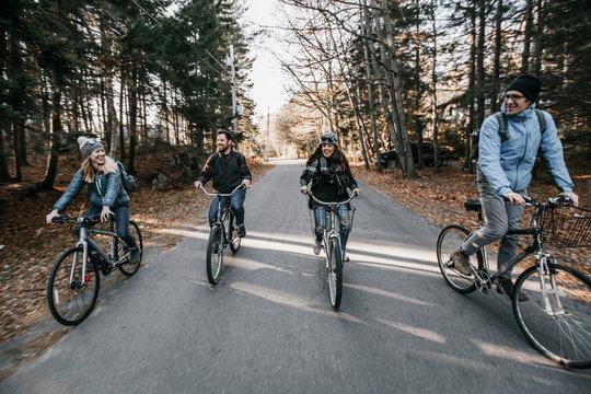 Group of friends riding on bikes, Peaks island, Maine, USA