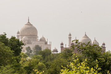 Taj Mahal in Agra, India. Mogul marble mausoleum with minarets, mosque and famous 17th century symmetrical gardens