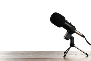 Microphone on table against white background. Space for text