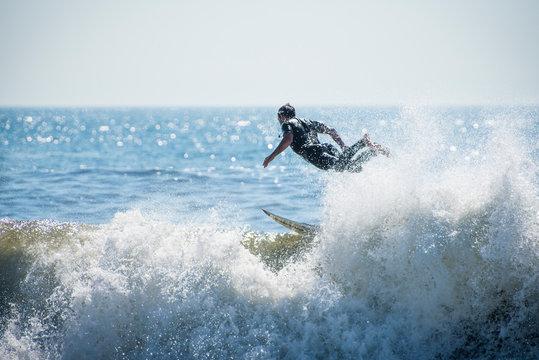 Surfer bailing on wave