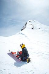 Man assembling snowboard, Mt Shasta, California, USA