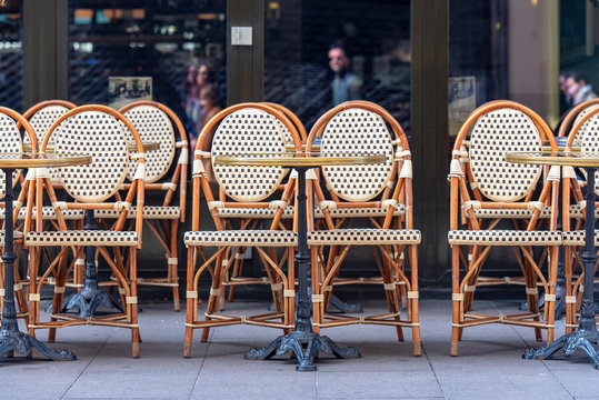 Rows of traditional Chairs of a Street Cafe in France, french furniture in a Street