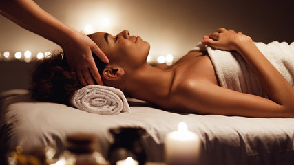 Girl having massage and enjoying aroma therapy in spa