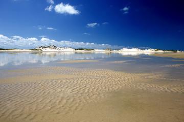 Blue sky over sandy coastal beach of Benguerra island, Mozambique