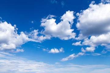 Cloudscape. Blue sky with large white clouds. Beautiful big clouds slowly float against the blue sky.