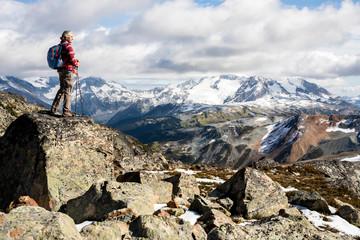 Female hiker looking at view of Garibaldi Provincial Park, Canada