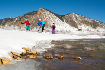 Group of people skiing by lake
