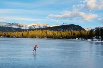 A girl ice skating on Molas Lake, San Juan National Forest, Silverton, Colorado.