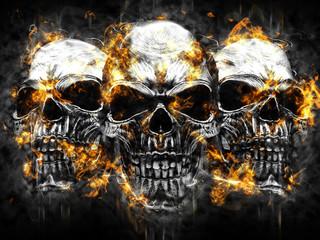 Three metal vampire skulls - burning fire and flames