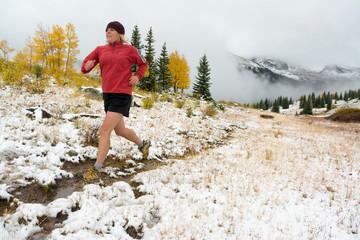 A woman trail running  on Molas Pass near Silverton, Colorado.