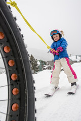 A girl getting a tow to the local ski resort, Silverton, Colorado.