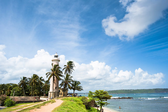 Galle Lighthouse against clouds during sunny weather, Galle, Sri Lanka