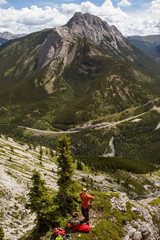 Hiker taking break, Rocky Mountains, Banff National Park, Alberta, Canada