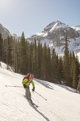 Girl skiing in mountains, Silverton, Colorado, USA