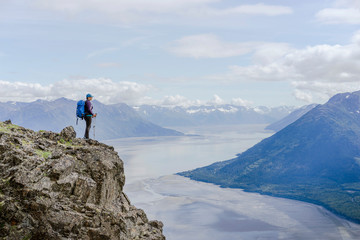 Woman standing at Hope Point over Turnagain Arm, USA