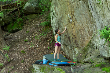 A Female Climber Studies The Wall She Is About To Climb In Bethesda, Maryland