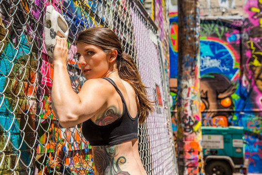 Athletic female exercising in Graffiti Alley in Baltimore, maryland