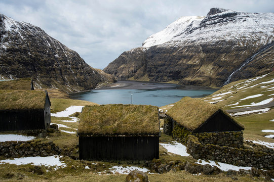 Turf houses by fjord, Saksun in Faroe Islands