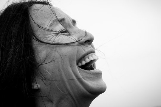 Close up of laughing woman, black and white
