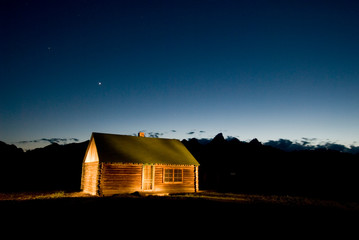 Light painting on a barn at sunset on June 16, 2007 in Grand Teton National Park, Wyoming.