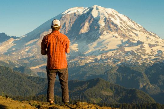 Portrait of Hiker in front of Mt Rainier Cascade Mountains