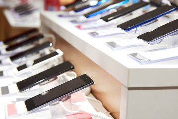Smartphones on the counter of a electronics store
