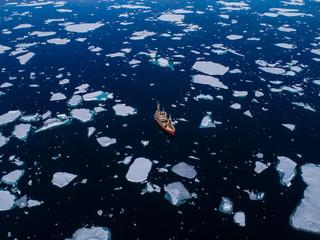 Boat in waters of Arctic Ocean, Spitsbergen, Svalbard and Jan Mayen, Norway
