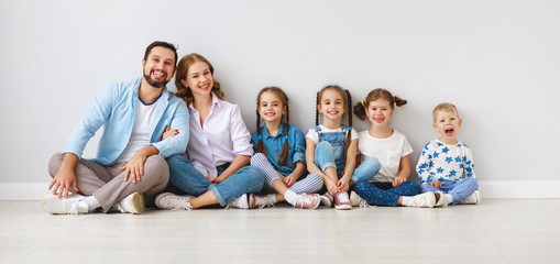 large family mother father and children sons and daughters on white background.