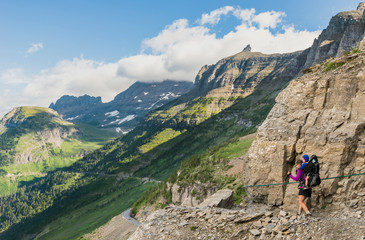 Women and child hiking on the Highline Trail in Glacier National Park, Montana.
