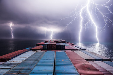Lightning storm at sea viewed from a container ship