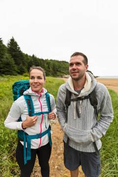 Couple hiking at Beach in Acadia National Park, Maine, USA