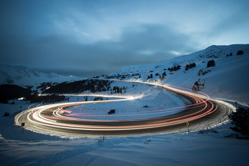 Long exposure of winter traffic on Colorado Highway 6 traveling over Loveland pass at night.