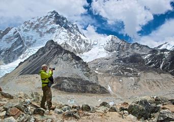 A photographer photographs the Himalayas