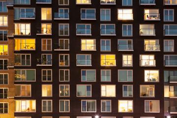 Modern apartment block at dusk
