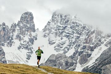 Man running on at Italian Dolomites