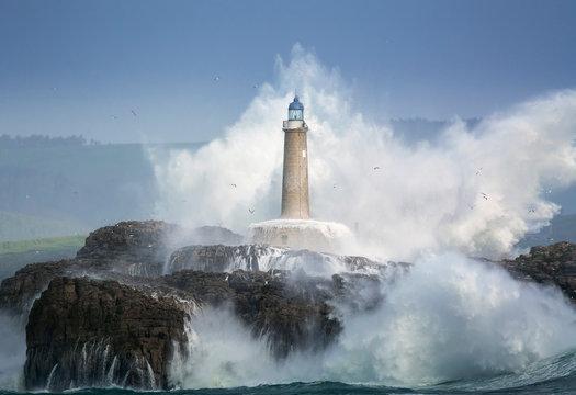 Waves crashing around lighthouse, Santander, Cantabria, Spain