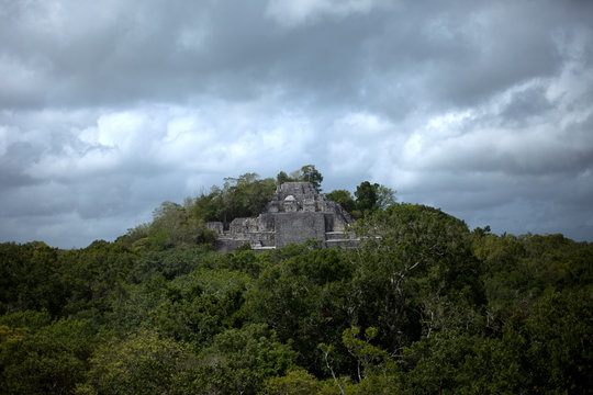 The Temple I of the Mayan city of Calakmul peaks over the jungle in the Calakmul Biosphere Reserve, Campeche state, Yucatan Peninsula, Mexico