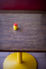 Abstract image of table top with salt container, Santa Cruz, California, USA