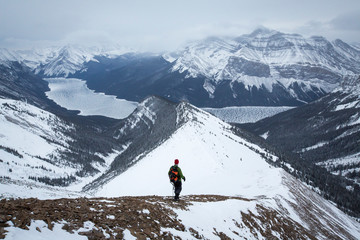Hiker at Mount Aylmer in winter, Banff National Park, Alberta, Canada