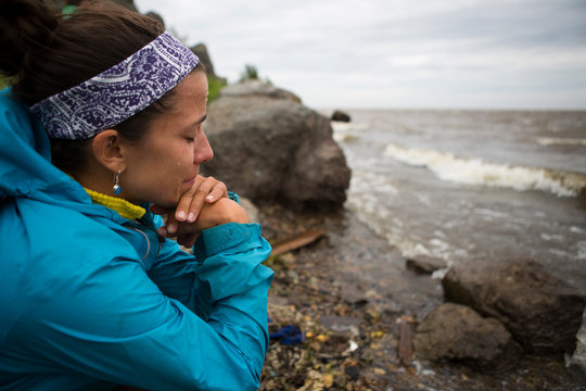 A woman becomes emotional upon reaching the shore of the Okhotsk Sea in far east Russia.