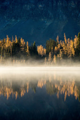 Foto op Canvas Ochtendstond met mist Mountain reflected in a lake, Mount Assinboine Provincial Park, British Columbia, Canada