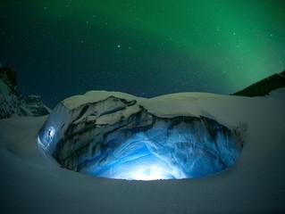 Ice climbing under aurora