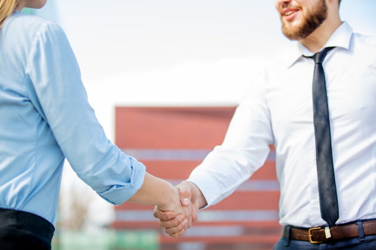 Busninesswoman and businessman have a shake hands