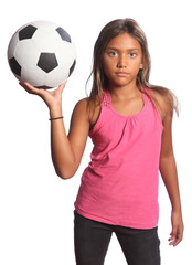 Young mixed race school girl holding soccer ball