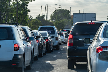 Bumper to bumper traffic jam on Caribbean island highway road. Vehicles drive on left hand side.